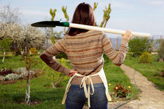woman-shovel-garden-back-view-portrait-40076385